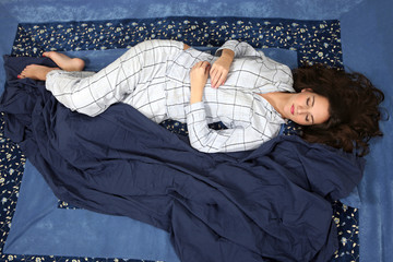 Woman sleeping on back position, comfort in bed