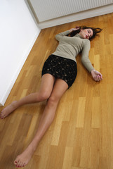 Dead girl body lying on floor