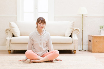 young asian woman relaxing in living room