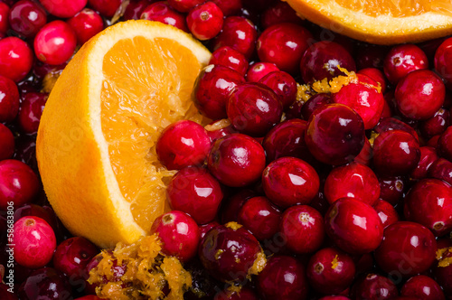 Cranberries and orange making cranberry sauce