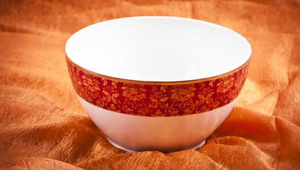 Ceramic brown dishware i on orange  background