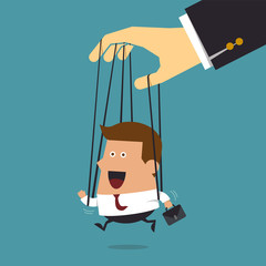 Young businessman marionette on ropes controlled.