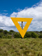 Shipping navigation yellow triangle sign on land