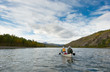Wilderness adventure canoeists paddle Pelly River