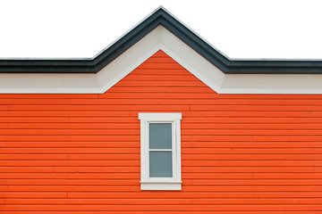 Exterior wall orange siding window and roof trim