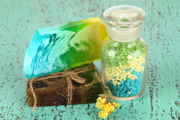 Hand made soaps with sea salt on wooden table close-up