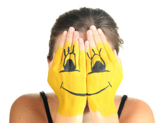 Portrait of girl hiding her face under smile mask isolated