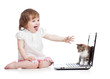 Funny child with laptop and cat baby