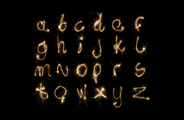 Shiny alphabet isolated on black