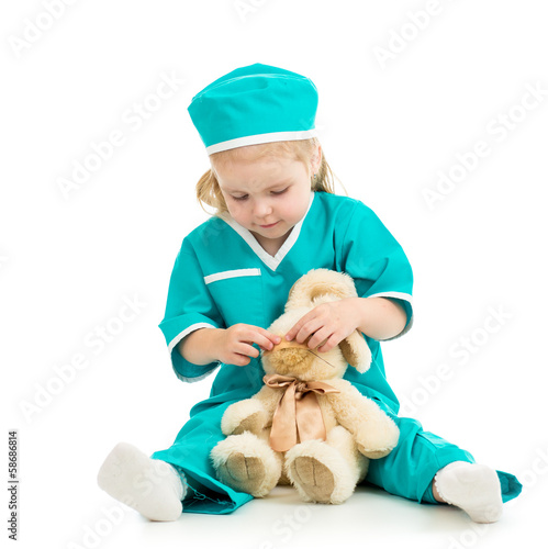 kid playing doctor and curing toy
