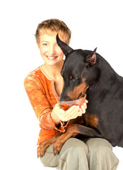 woman feeding hungry pet dog by red caviar
