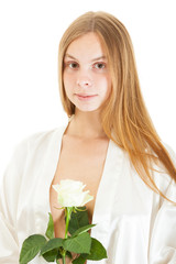 portrait of a beautiful nude girl with white rose