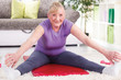 Senior woman stretching and exercise at home