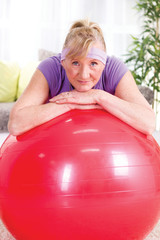 Senior woman after exercises relaxes