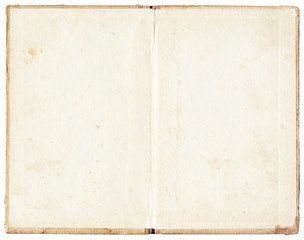 old stained open book on white background