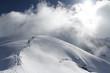 Skiers climbing a snowy mountain - 58691259