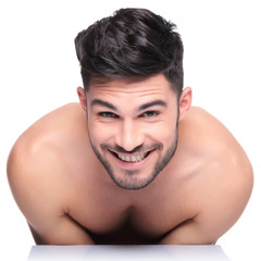 shy young naked man smiling to the camera