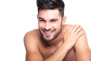 smiling naked man with hand on his shoulder