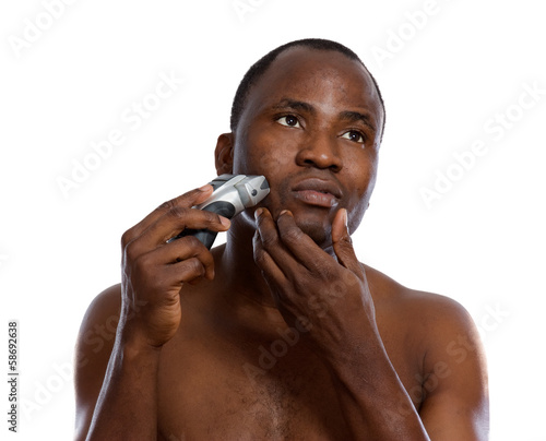 An african-american man shaving, isolated on white.
