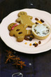 Gingerbread cookies and mince pie on ceramic plate