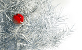 Christmas red ball on snowy conifer