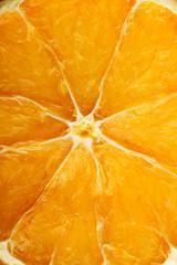 Piece of orange, close up.