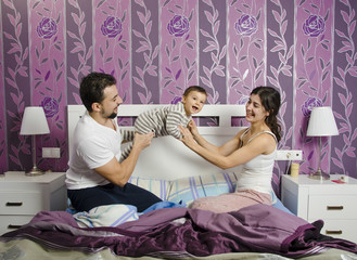 Family playing in bedroom