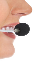 Close up on female's mouth with microphone.