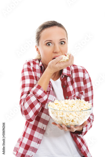 Young casual woman eating popcorn.