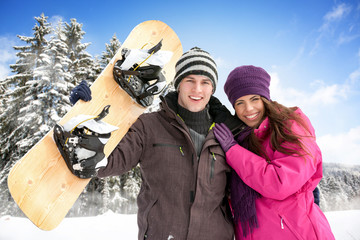 Adorable couple enjoying in wintertime