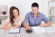 Couple Calculating Bills