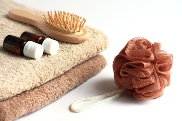 Towels, washcloth and a comb on a white background.