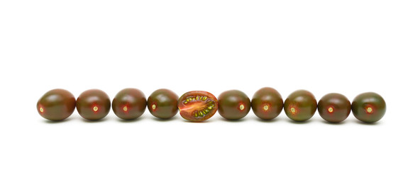 black cherry tomatoes on a white background