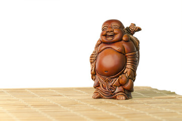 Statuette of laughing Buddha on a white background
