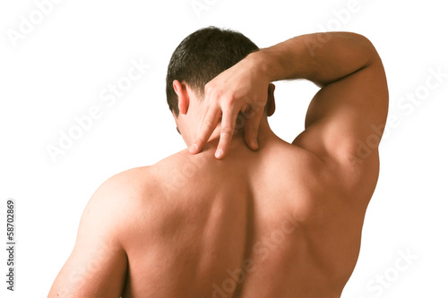 Muscular man with back neck ache isolated on white background.