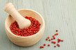 mortar and pestle with red peppercorns