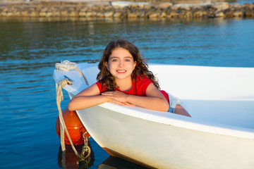 Sailor kid girl happy smiling relaxed in boat bow