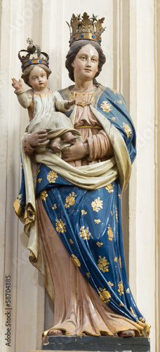 Leuven - Carved statue of Madonna form St. Michaels church
