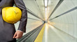 Leinwandbild Motiv engineer yellow helmet for workers security with construction pl