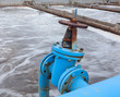 Blue valve on gas pipeline into sewage