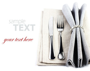 Elegant Festive table setting place with fork and knife on a gre