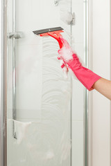 Cleaning a shower with a squeegee