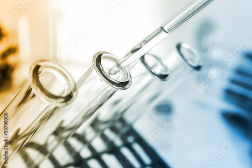 pipette and test tube on coloured background - 58708006