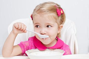 cute little girl eats