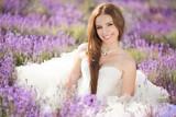 Fototapety Bride in wedding day in lavender field