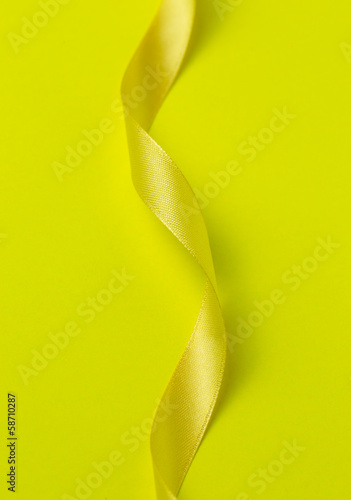Yellow ribbon on yellow background