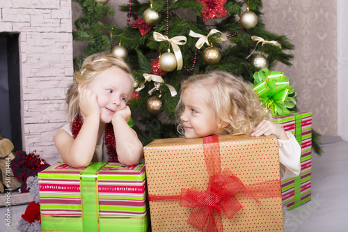 little girls with Christmas gifts
