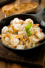 shrimp in a garlic, butter and herb sauce.