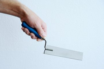 Hand with trowel