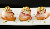 three bacon-wrapped scallop appetizers
